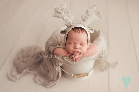 Newborn babies, and Christmas props, it doesn't get much cuter than that! Make sure you are prepared for your newborn's photo session with this list of props.