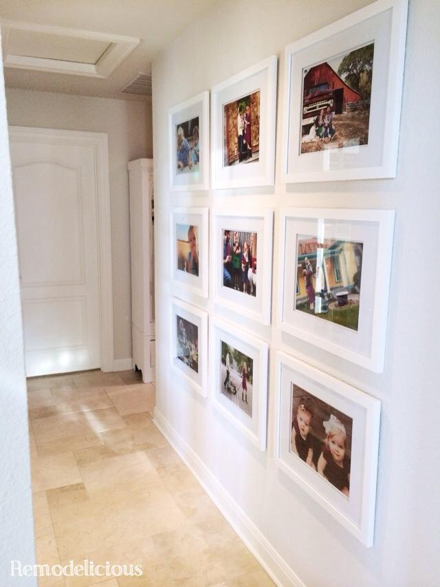I love a good family photo wall gallery. I love how it tells your family's story in pictures. It's such a fun way for people to get to know you when they visit your home.